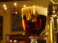 Close-up of a glass of Gouden Carolus